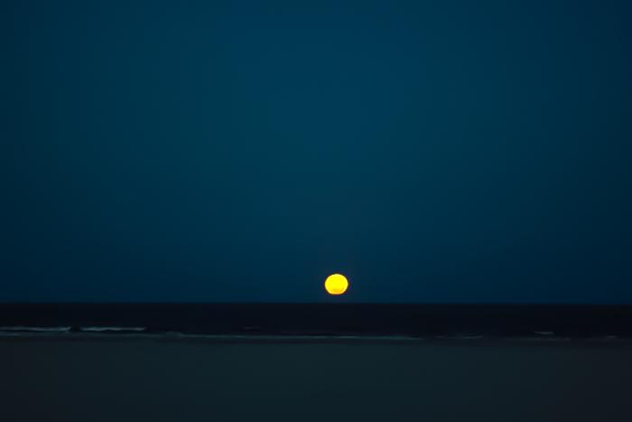 full moon rises over Pacific Ocean at South Stradbroke Island