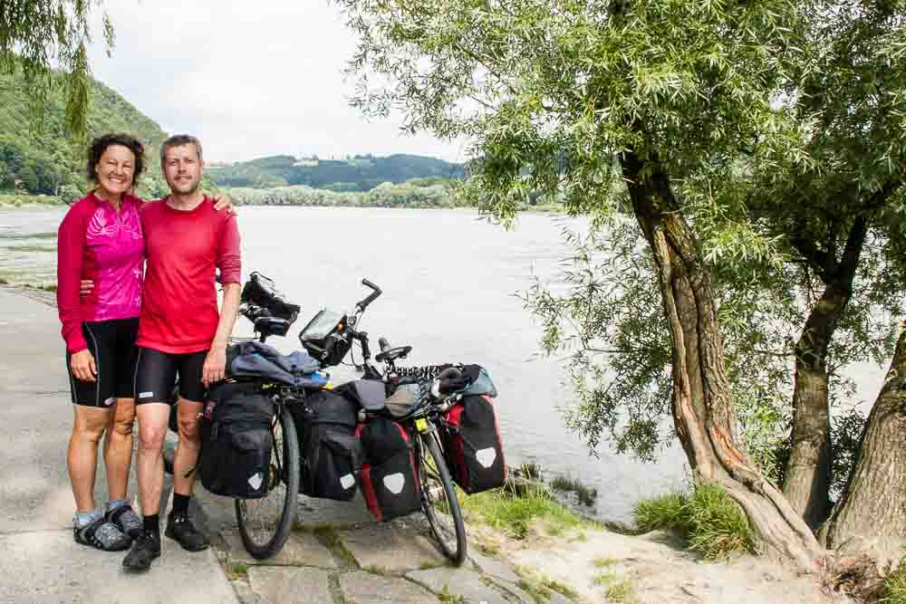 Cyclists Claire and Dave on confluence of Inn River and Danube at Passau